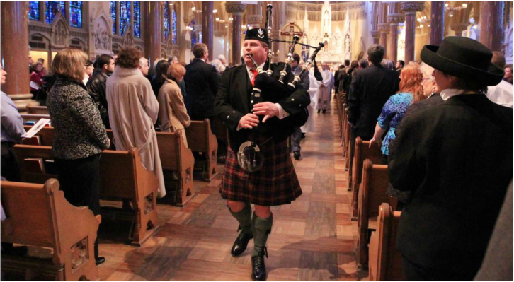 Piper leading funeral from church